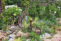 Dan Johnson used some salvaged metal rails to create several thematic curvy  sculptures in his backyard Denver garden.