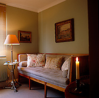 The spare bedroom is furnished with an 18th century German sofa upholstered with striped fabric by John Stefanidis