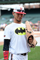Anthony Molina (23) of Somerset Academy in Pembroke Pines, Florida using an large toy before the Under Armour All-American Game on August 16, 2014 at Wrigley Field in Chicago, Illinois.  (Mike Janes/Four Seam Images)