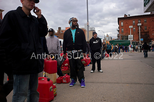 Brooklyn, New York.November 2, 2012..Lining up for gas at a station in Brooklyn on 4th Ave. Shortages of gas appeared days after Hurricane Sandy swept through the Northeast US coast. ..Drivers waited up to 7 hours to fill their tanks. Line stretched for blocks for those in cars and those looking to fill small jugs. ...