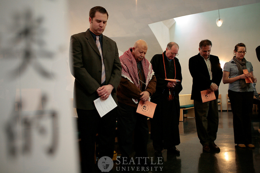 Chris Joseph Taylor I Seattle University..Guests from the Jewish, Islamic, Christian and Buddhist traditions stand together during a closing prayer and blessing during a Interfaith Prayer for Peace Thursday afternoon at The Chapel of St. Ignatius.