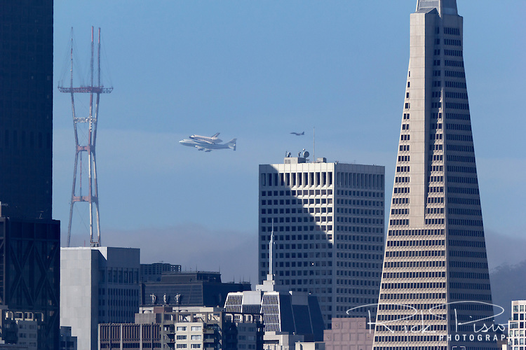 Space Shuttle Endeavour with its 747 escort flies over San Francisco during the spacecrafts final flight to Southern California.