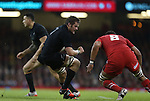 All Blacks captain Richie McCaw takes on Wales number 8 Taulupe Faletau.<br /> Dove men Series 2014<br /> Wales v New Zealand<br /> 22.11.14<br /> &copy;Steve Pope -SPORTINGWALES