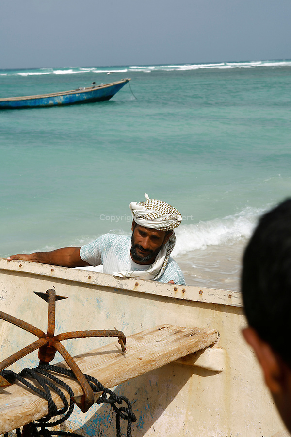 .fisherman  on the  Qalantsiya beach. Socotra. Yemen