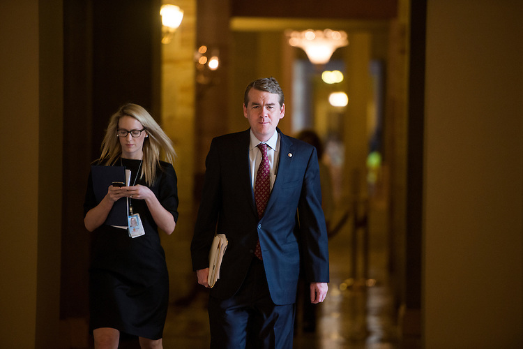 UNITED STATES - MAY 15: Sen. Michael Bennet, D-Colo., walks to the Senate chamber on Wednesday, May 15, 2013. (Photo By Bill Clark/CQ Roll Call)