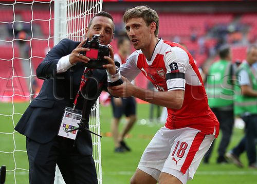 May 27th 2017, Wembley Stadium, London England;  FA Cup Final, Arsenal versus Chelsea FC; Santi Cazorla of Arsenal and Nacho Monreal of Arsenal attempted to take a selfie with one of the remote cameras during Arsenal's celebration after defeating Chelsea by 2-1