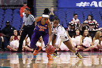 GREENSBORO, NC - MARCH 6: Shania Meertens #31 of Clemson University and Marnelle Garraud #14 of Boston College challenge for a loose ball during a game between Clemson and Boston College at Greensboro Coliseum on March 6, 2020 in Greensboro, North Carolina.