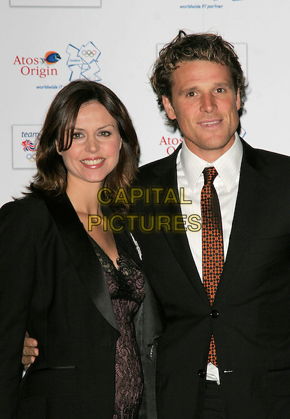 BEVERLEY TURNER & JAMES CRACKNELL .attends the Olympic Gold Ball at the Natural History Museum, London, England, October 8th 2008..half length black suit tie jacket purple lace dress.CAP/AH.©Adam Houghton/Capital Pictures
