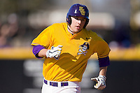 John Wooten #16 of the East Carolina Pirates rounds the bases after hitting a home run in his first college at bat against the Virginia Cavaliers at Clark-LeClair Stadium on February 20, 2010 in Greenville, North Carolina.   Photo by Brian Westerholt / Four Seam Images