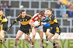 Brendan O'Keeffe Rathmore goes past Daithi Casey and Killian Fitzgerald Crokes during the O'Donoghue Cup final in Fitzgerald Stadium on Sunday
