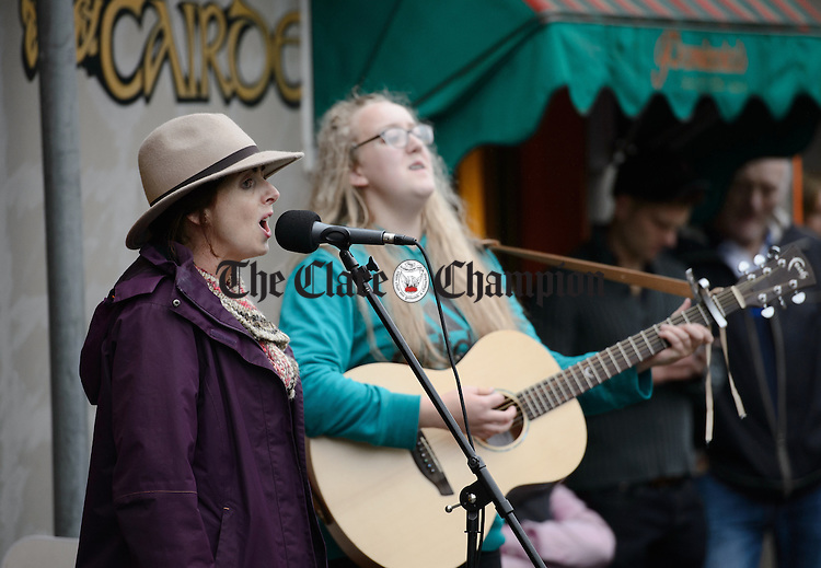 Deirdre Mulvey of Westmeath joins The  Dying Kicks who were playing at Barrack street during Fleadh Cheoil na hEireann in Ennis. Photograph by John Kelly.