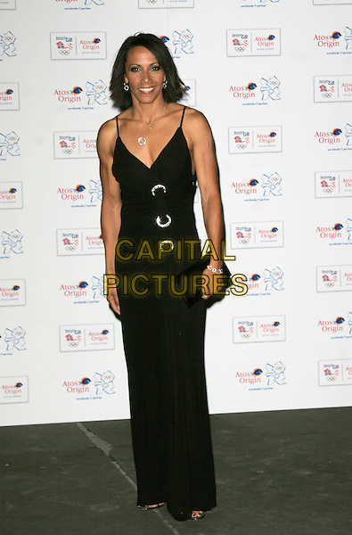 DAME KELLY HOLMES .attends the Olympic Gold Ball at the Natural History Museum, London, England, October 8th 2008..full length long maxi black dress clutch bag .CAP/AH.©Adam Houghton/Capital Pictures