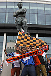 LONDON, ENGLAND - MAY 20: 2011-12 Luton fans in front of the Bobby Moore statue, captain of England's World Cup winning team in 1966, before the Blue Square Bet Conference League promotion final between Luton Town FC and York City FC at Wembley Stadium on May 20, 2012 in London, England. (Photo by Dave Horn - Extreme Aperture Photography)