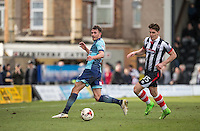 Will De Havilland of Wycombe Wanderers plays a pass under pressure from Sam Jones of Grimsby Town during the Sky Bet League 2 match between Grimsby Town and Wycombe Wanderers at Blundell Park, Cleethorpes, England on 4 March 2017. Photo by Andy Rowland / PRiME Media Images.