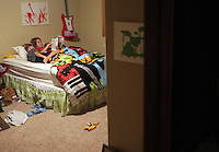 Heather Jacobs reads bedtime books with her sons Keenan, 7, and Ethan, 5, in their Polk City home.  Bedtime is cherished by Heather, as it is about the only time in the day where she will get one-on-one time with each of her children. Heather lost her husband, Eric, in a plane crash in 2006 when she was eight months pregnant with their youngest, Ella, and has since been raising her five young children on her own.