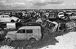 French landscape cars dumped in fields . Scrap metal 1960s Normandy France. 1967