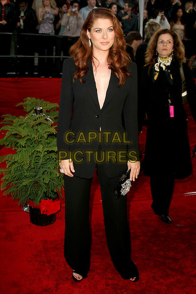 DEBRA MESSING.31st Annual People's Choice Awards held at the Pasadena Civic Auditorium,  Pasadena, California, USA, .09 January 2005 .full length black suit.Ref: ADM.www.capitalpictures.com.sales@capitalpictures.com.©Charles Harris/AdMedia/Capital Pictures .