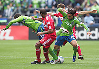 From left, Seattle Sounders FC forward O'Brian White, Chicago Fire midfielder Logan Pause, Seattle Sounders FC forward Mauro Rosales and Chicago Fire midfielder Mike Videira get tangled up during play at Qwest Field in Seattle Tuesday April 8, 2011. The Sounders won the game 2-1.