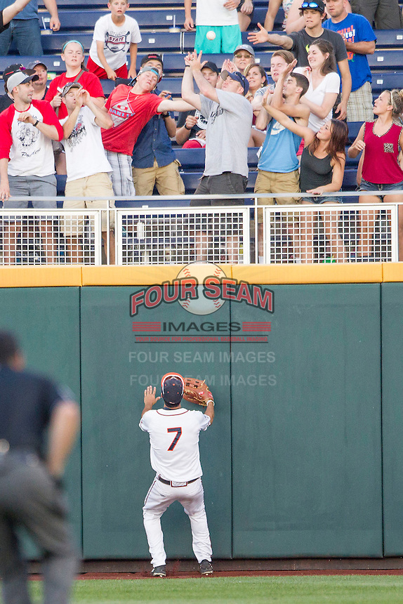 Virginia Cavaliers outfielder Adam Haseley watches the ball fly over the wall after Florida Gators Harrison Bader (8) hit a home run during Game 13 of the NCAA College World Series on June 20, 2015 at TD Ameritrade Park in Omaha, Nebraska. The Cavaliers beat the Gators 5-4. (Andrew Woolley/Four Seam Images)