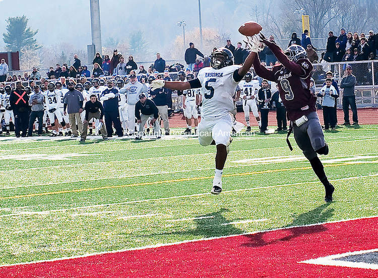 Naugatuck, CT- 26 November 2015-112615CM16-  Ansonia's Tyler Bailey (5) goes up for the ball against Naugatuck's Dan Oladapo during their Thanksgiving matchup against Naugatuck on Thursday. Although the pass was incomplete, the Chargers would rout the Greyhounds,  41-8.   Christopher Massa Republican-American