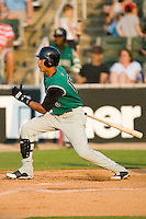 Ehire Adrianza #15 of the Augusta GreenJackets follows through on his swing versus the Kannapolis Intimidators at Fieldcrest Cannon Stadium July 25, 2009 in Kannapolis, North Carolina. (Photo by Brian Westerholt / Four Seam Images)