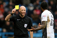 Referee Mr Andy Davies shows a yellow card to Peterborough United's Anthony Grant during Gillingham vs Peterborough United, Sky Bet EFL League 1 Football at the MEMS Priestfield Stadium on 10th February 2018