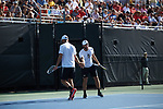 Petros Chrysochos (right) of the Wake Forest Demon Deacons slaps hands with doubles partner Bar Botzer during their match against the Ohio State Buckeyes during the 2018 NCAA Men's Tennis Championship at the Wake Forest Tennis Center on May 22, 2018 in Winston-Salem, North Carolina. (Brian Westerholt/Sports On Film)