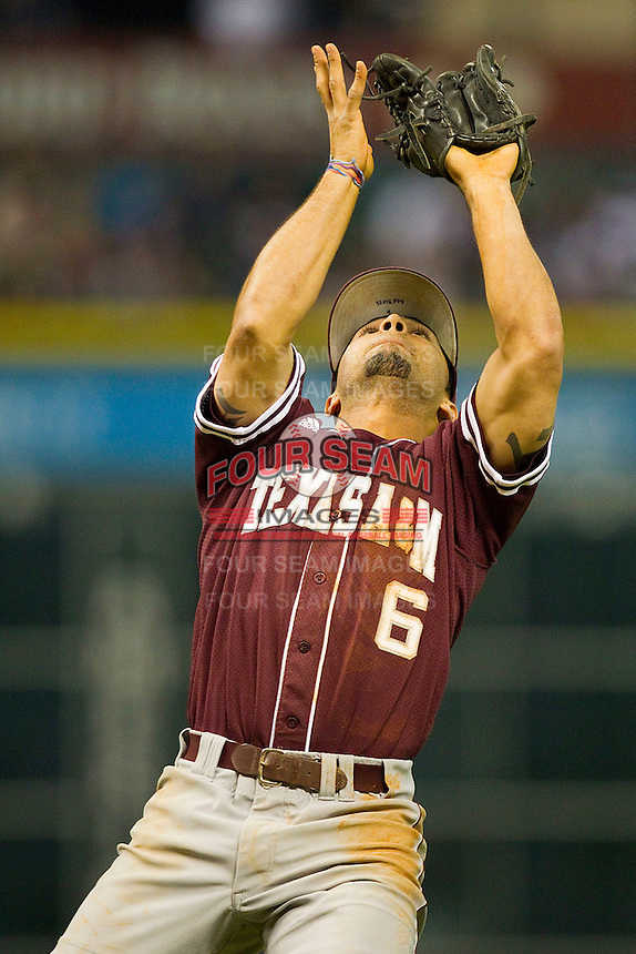 Third baseman Andrew Collazo #6 of the Texas A&M Aggies tracks a pop fly in the infield against the Rice Owls at Minute Maid Park on March 5, 2011 in Houston, Texas.  Photo by Brian Westerholt / Four Seam Images