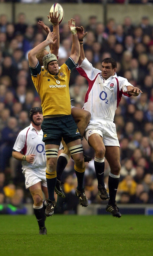 Photo. Richard Lane.England v Australia at Twickenham. 16-11-2002.Investec Challenge Cook Cup..David Giffin gets up for a high ball with Martin Johnson and Lewis Moody.