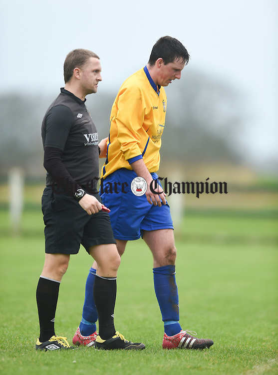 Stephen Kelly of Clare is helped off injured during their FAI Oscar Traynor game against Limerick. Photograph by John Kelly.