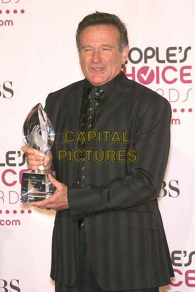 ROBIN WILLIAMS (winner Favorite Funny Male Star).The 33rd Annual People's Choice Awards - Press Room held at The Shrine Auditorium, Los Angeles, California, USA..January 9th, 2007.half length black suit jacket award trophy striped stripes funny face.CAP/ADM/ZL.©Zach Lipp/AdMedia/Capital Pictures