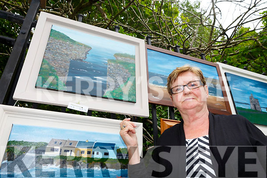 Peggy Casey from Ballyheigue displaying her art work at the Art Exhibition in Denny Street on Saturday morning.