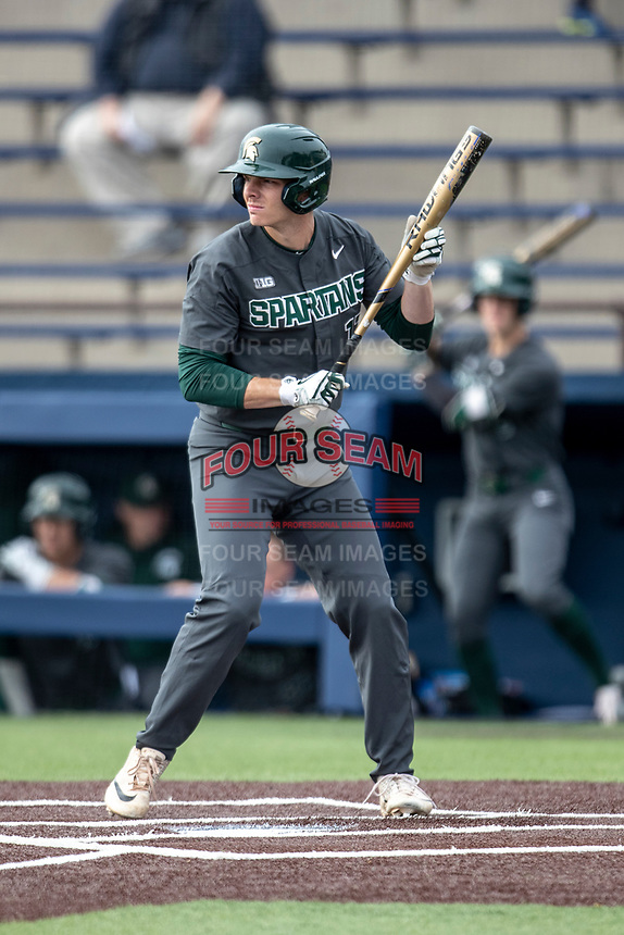 Michigan State Spartans outfielder Bryce Kelley (17) squares to bunt in the NCAA baseball game against the Michigan Wolverines on May 7, 2019 at Ray Fisher Stadium in Ann Arbor, Michigan. Michigan defeated Michigan State 7-0. (Andrew Woolley/Four Seam Images)