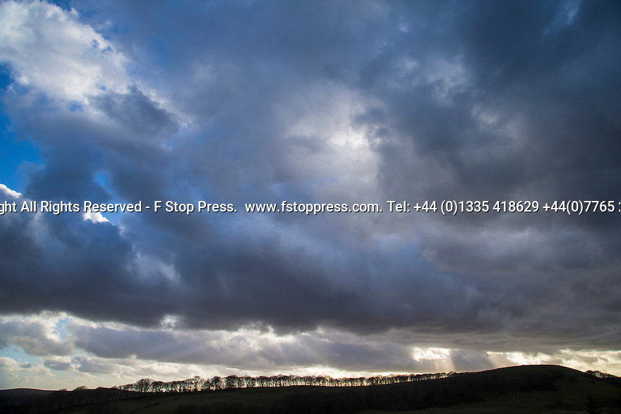 02/03/15  <br /> <br /> Sunbeams, known as crepuscular rays, shine through wintery skies over Sparrowpit in the Derbyshire Peak District. <br /> <br /> All Rights Reserved - F Stop Press.  www.fstoppress.com. Tel: +44 (0)1335 418629 +44(0)7765 242650