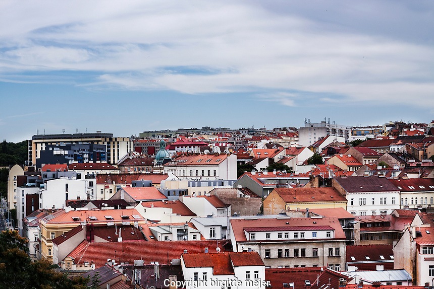 Cityscape from Vitkov Hill in district 3 in Prague, with the blue sky as backdrop