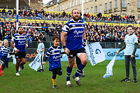 Tom Dunn of Bath Rugby mascot in hand runs out onto the field. Gallagher Premiership match, between Bath Rugby and Harlequins on March 2, 2019 at the Recreation Ground in Bath, England. Photo by: Patrick Khachfe / Onside Images