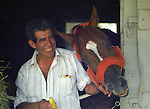 Affirmed (Exclusive Native) at Saratoga in 1979 with his groom Juan Alaniz