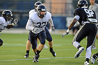 12 August 2011:  FIU's Zach Schaubaut (33) prepares to block Paul Crawford (92) during a scrimmage held as part of the FIU 2011 Panther Preview at University Park Stadium in Miami, Florida.