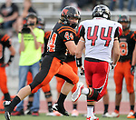 SIOUX FALLS, SD - SEPTEMBER 27:  Logan Raabe #44 from Washington looks at the defense of Lucas Lunstra #44 from Brandon Valley in the first quarter of their game Friday night at Howard Wood Field. (Photo by Dave Eggen/Inertia)