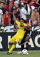WASHINGTON, DC - AUGUST 4, 2012:  Brandon McDonald (4) of DC United holds onto Jairo Arrieta (25) of the Columbus Crew during an MLS match at RFK Stadium in Washington DC on August 4. United won 1-0.