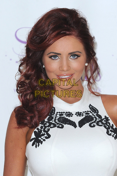 Amy Childs launches her fourth clothing collection for Spring / Summer 2013, Millenium Mayfair Hotel, London, England..30th January 2013.headshot portrait white sleeveless black  lace embroidered .rCAP/BEL.©Tom Belcher/Capital Pictures.