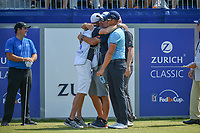 Henrik Stenson (SWE) and Justin Rose (GBR) share a group hug with the caddies before Round 3 of the Zurich Classic of New Orl, TPC Louisiana, Avondale, Louisiana, USA. 4/28/2018.<br /> Picture: Golffile | Ken Murray<br /> <br /> <br /> All photo usage must carry mandatory copyright credit (&copy; Golffile | Ken Murray)