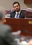 Nevada Sen. Ruben Kihuen, D-Las Vegas, works in committee at the Legislative Building in Carson City, Nev., on Wednesday, Feb. 11, 2015. <br /> Photo by Cathleen Allison
