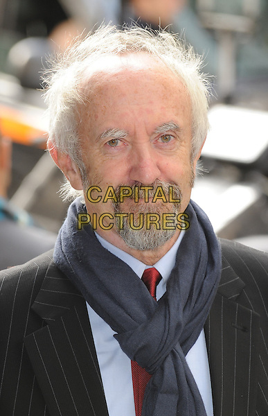 JONATHAN PRYCE.100 Years Of The London Palladium, London, England, UK, .October 12th, 2010..headshot portrait black pinstripe jacket blue shirt scarf goatee facial hair .CAP/WIZ.© Wizard/Capital Pictures.