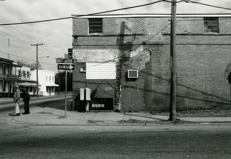 1993 March 22..Conservation.Huntersville 1 (R-70)..North Huntersville Study.Sequence 53.Harold's Market side view Washington Avenue.North side...NEG#.NRHA#.CONSERV:N.Hunt  1   4:9  FR5.