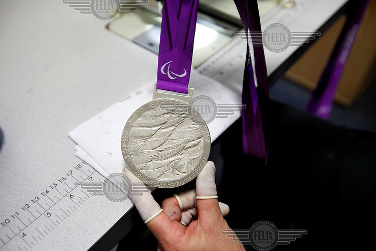 A London 2012 Paralympic silver medal, made by the Royal Mint, near Llantrisant in Mid Glamorgan. The medals were designed by Lin Cheung, a jewellery artist and senior lecturer in Jewellery Design at Central Saint Martins College of Arts and Design.