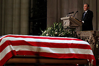 Former President George W. Bush speaks in front of the flag-draped casket of his father, former President George H.W. Bush, at the State Funeral at the National Cathedral, Wednesday, Dec. 5, 2018, in Washington. <br /> Credit: Alex Brandon / Pool via CNP / MediaPunch