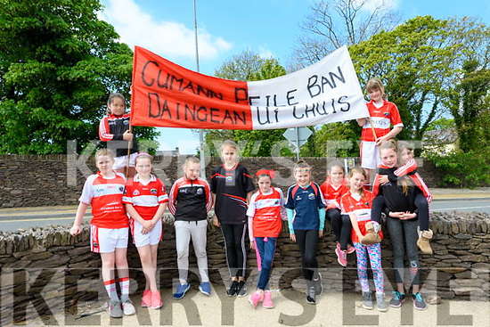 The girls from Cumann Peile Ban Daingean Uí Chúis ready for the La na gclub parade in Dingle on Sunday afternoon.