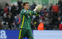 Hull City goalkeeper Eldin Jakupovic celebrates his team's win during the Premier League match between Swansea City and Hull City at the Liberty Stadium, Swansea on Saturday August 20th 2016