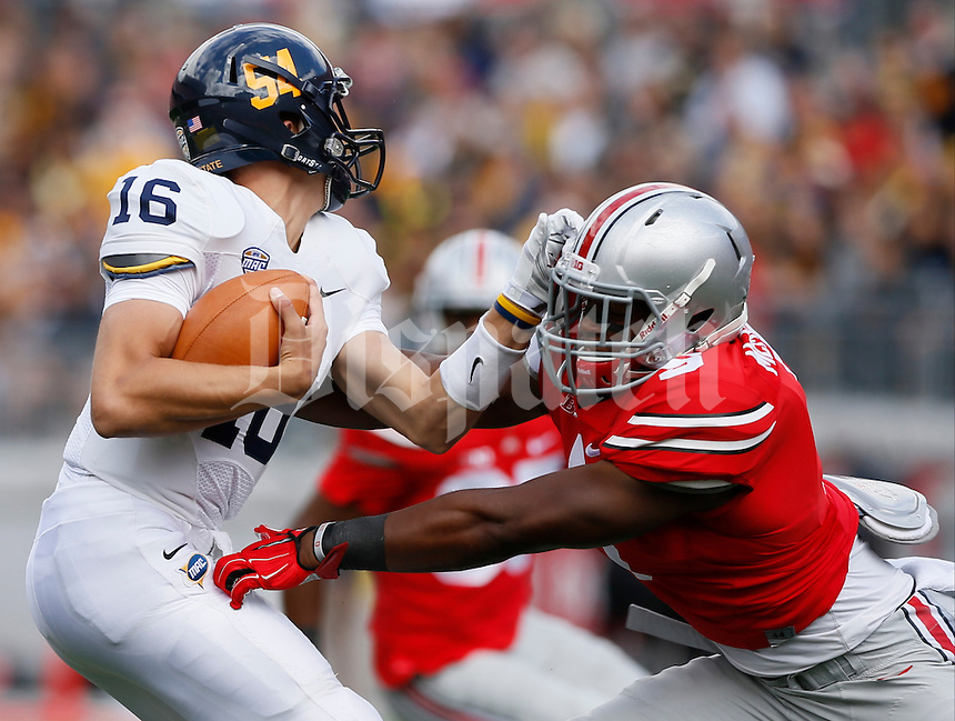 Kent State Golden Flashes quarterback Nathan Strock (16) is sacked ny Ohio State Buckeyes linebacker Raekwon McMillan (5) during Saturday's NCAA Division I football game at Ohio Stadium in Columbus on September 13, 2014. (Dispatch Photo by Barbara J. Perenic)